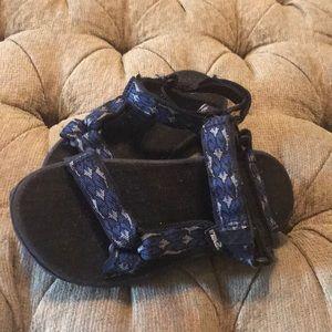 Teva kids blue/white Velcro closure sandals.